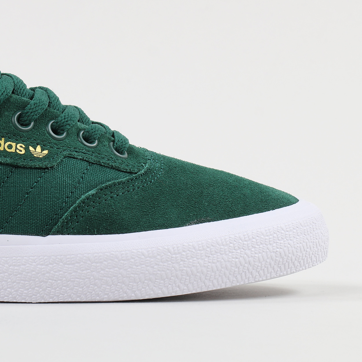 A pair of sneaks from adidas Skateboarding made from a blend of lightweight  canvas and suede in the uppers and a vulcanised rubber outsole with a  hexagonal ... 551de4b10