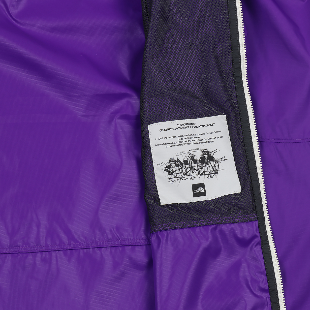 444423cab92b Lightweight WindWall technology protects you from seasonal wind and rain.  It features a Durable Water Repellent finish and comes from TNF s iconic  Black ...