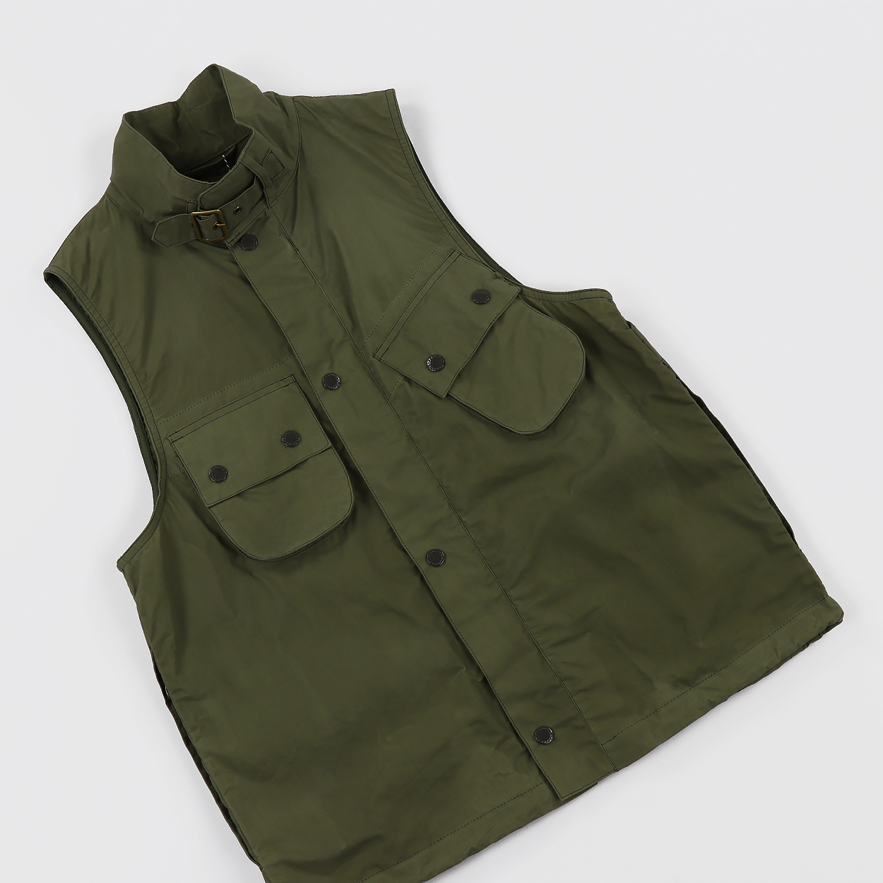 0cdcd0869d607 A functional vest from Barbour x Engineered Garment modelled on the  Westmorland gilet. The jacket is made from 100% cotton canvas with an  adjustable fit.