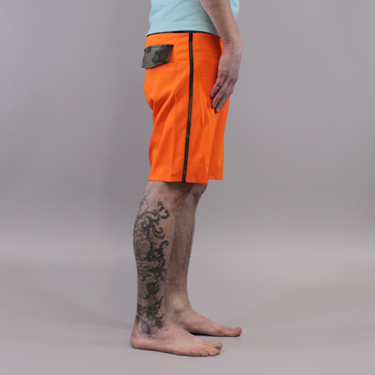 732869f657 Be ready to look cool and to be seen in these orange boardshorts with  camouflage waistband. Fox