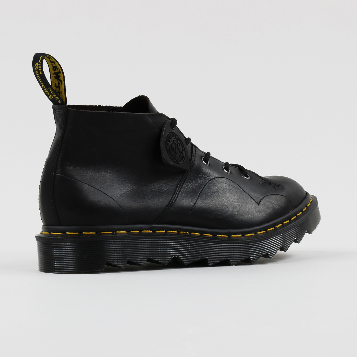 4fae90ba3199b1 A pair of ankle boots from Dr Martens  Made In England collection made from  the Classic Oiled Shoulder leather which is waxed and weather-resistant.