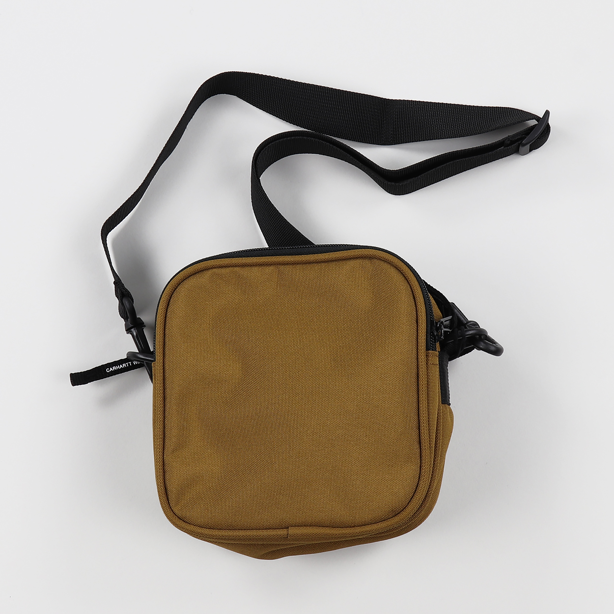 675cedcc7 A durable and small capacity bag from the guys at Carhartt Work In Progress  that can be worn in a variety of ways for all your essential bits and  pieces.