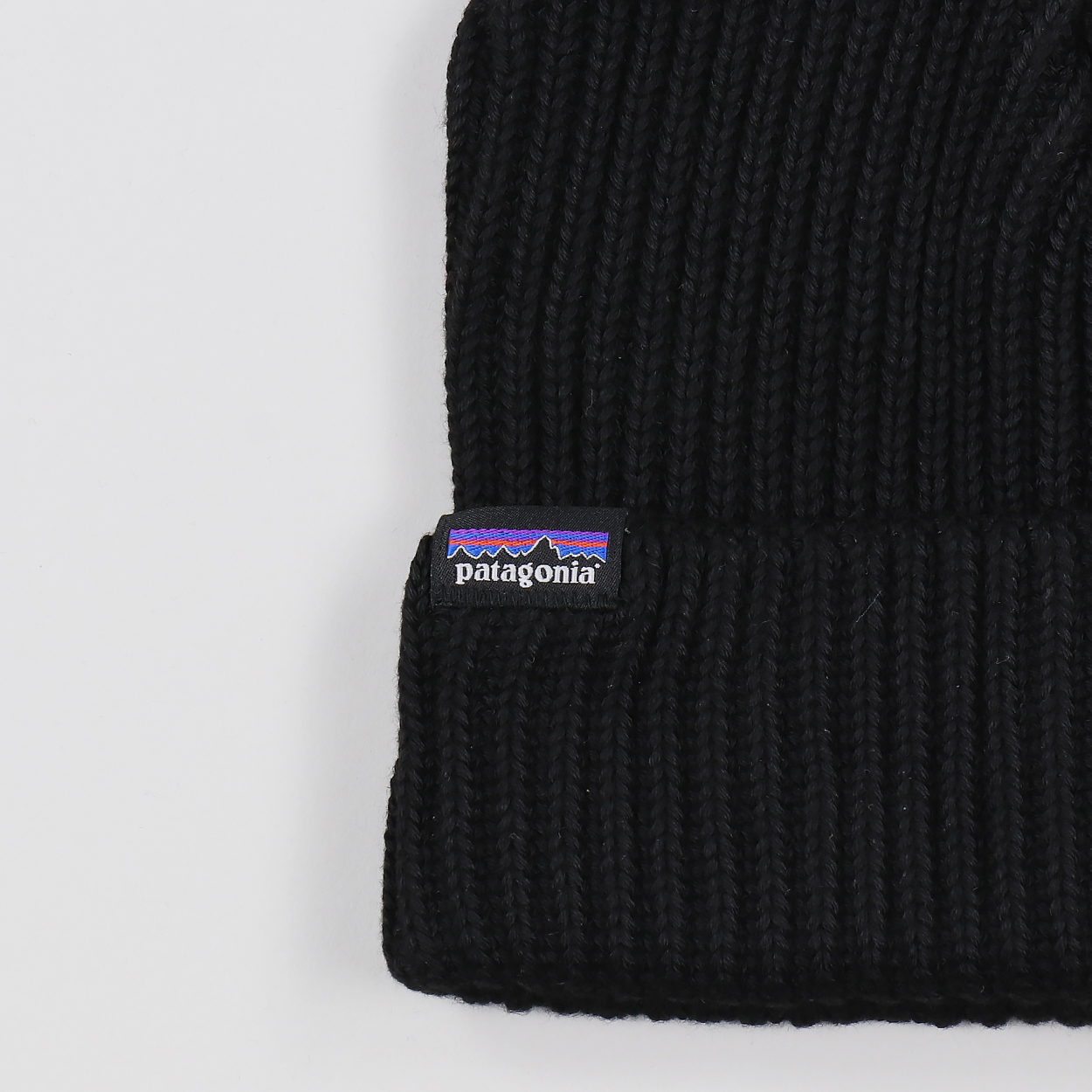 148a202123c Patagonia s standard cuffed and rolled beanie hat with their iconic P-6  logo tab. Super soft