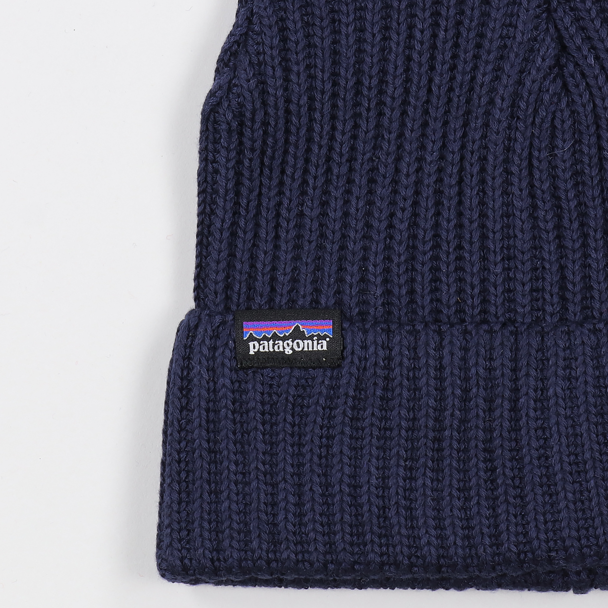 eca5c14c Patagonia's standard cuffed and rolled beanie hat with their iconic P-6  logo tab. Super soft, ribbed and comfortable for all-day-all-night cold  conditions.