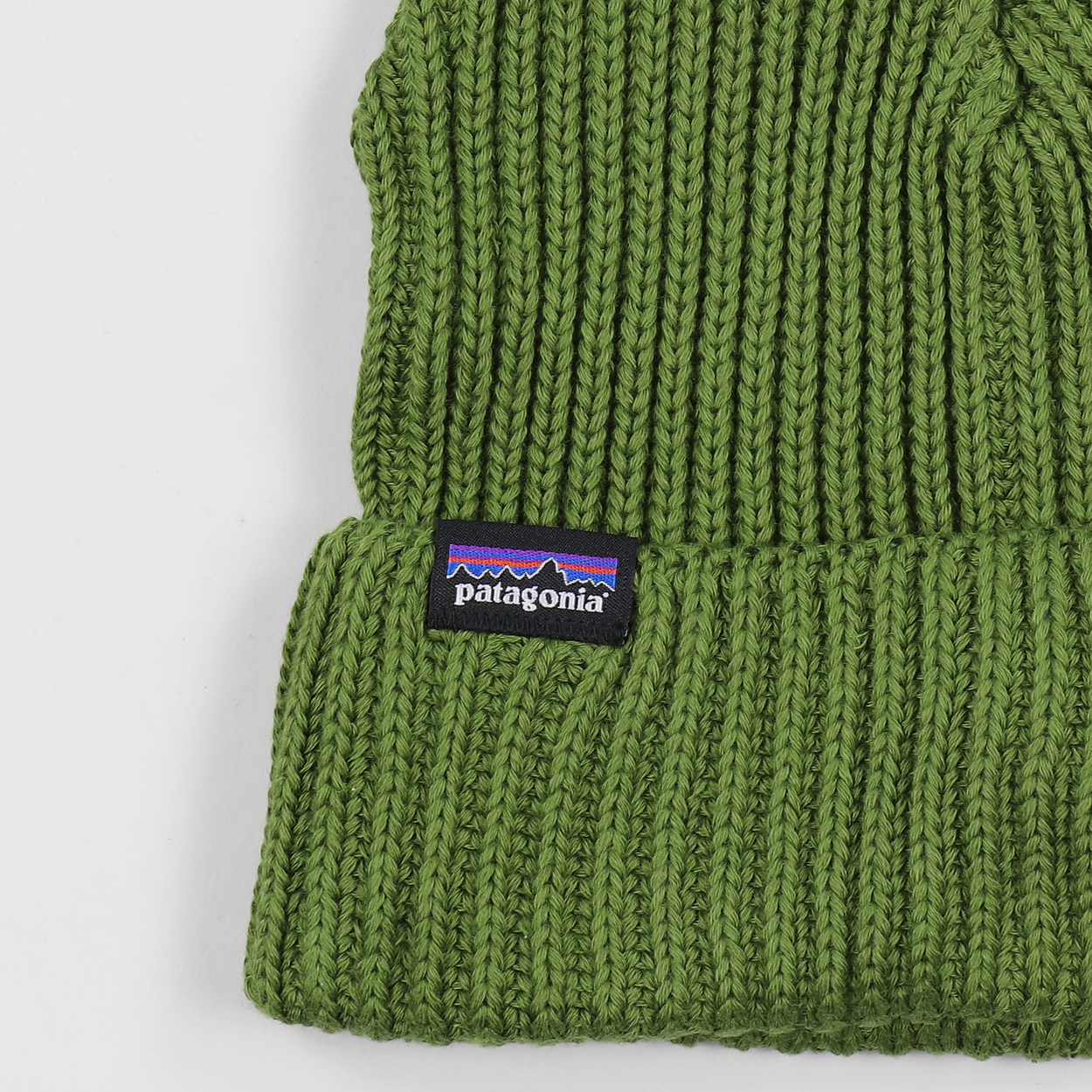 d8310035cbe Patagonia s standard cuffed and rolled beanie hat with their iconic P-6  logo tab. Super soft