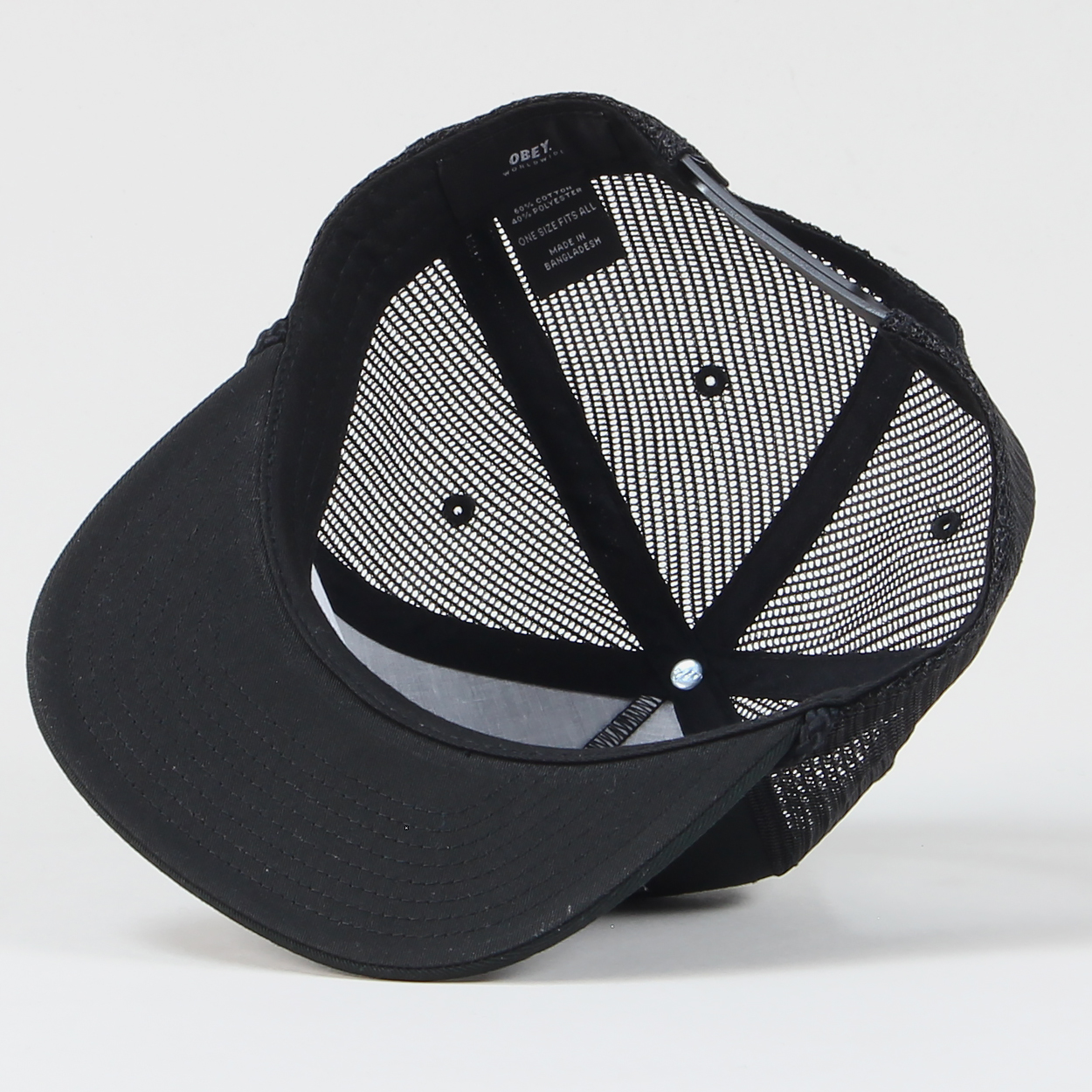 8231b5ab6cf A full black trucker hat featuring Obey s world famous original  Giant   logo stitched on to the front. Includes a lace strip along the back of the  peak and ...