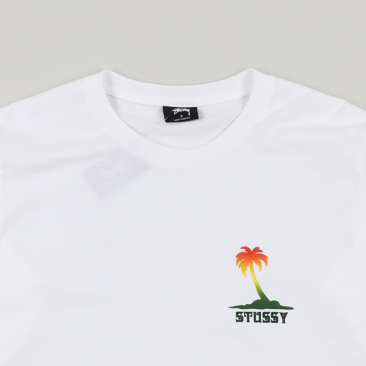fb160ea32 A long sleeved cotton tee from Stussy with a ribbed crew neck and ribbed  cuffs. Has a printed graphic to the chest and down the sleeves with proper  summer ...