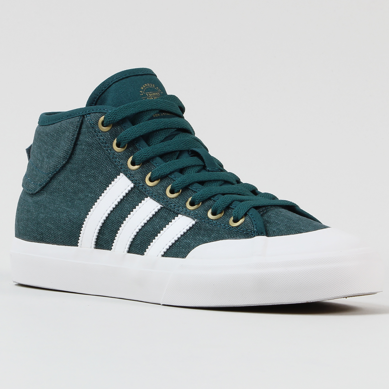 watch 311f5 f934f Adidas Skateboarding Matchcourt mid top trainers with vulcanized sole unit,  rubberized toe, iconic three stripes, canvas body, adidas pull tab at the  back.