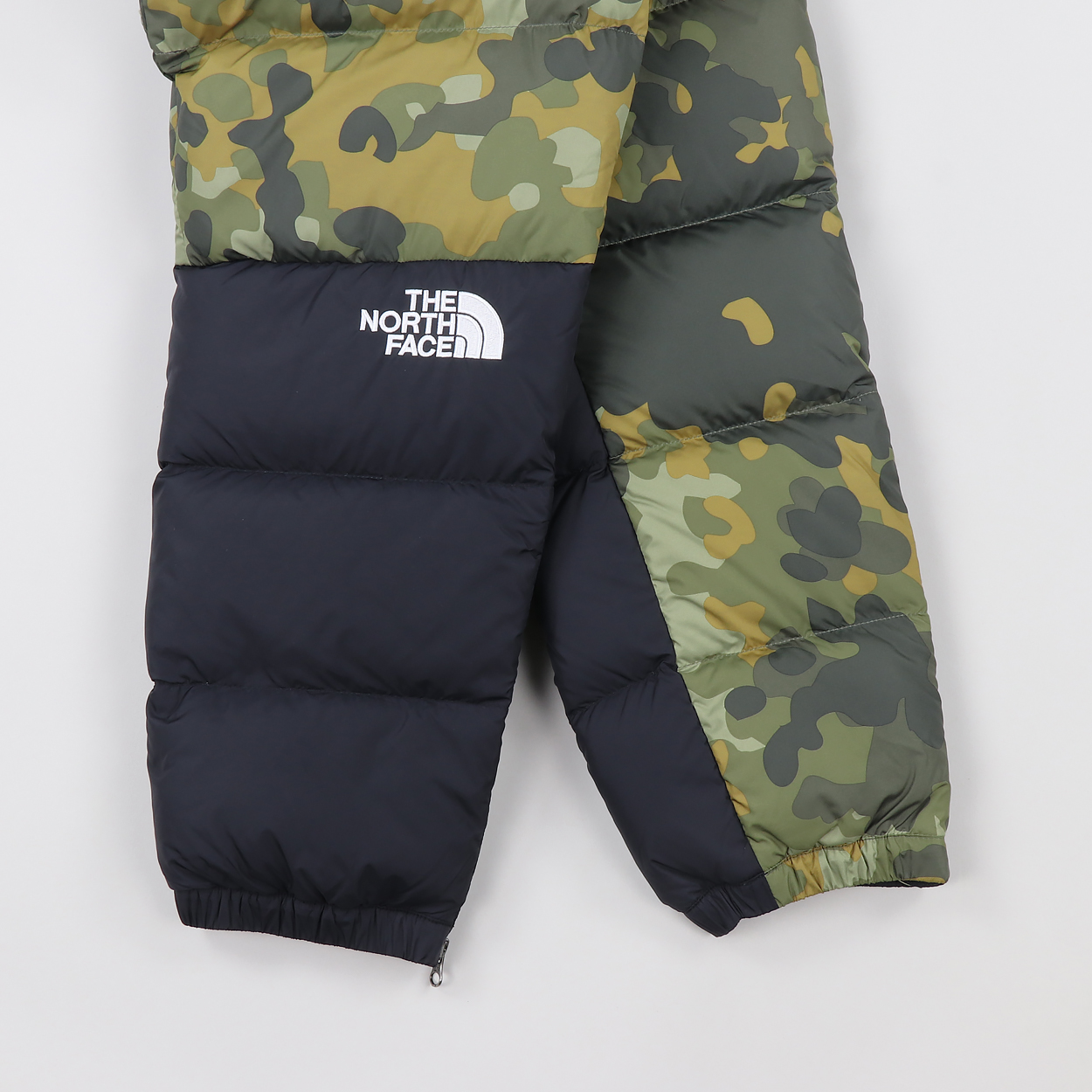 6f82ec9b3da74 A pair of insulated dungarees from The North Face's legendary Nuptse  collection. Made from 100% nylon ripstop with a Durable Water Repellent  finish and ...