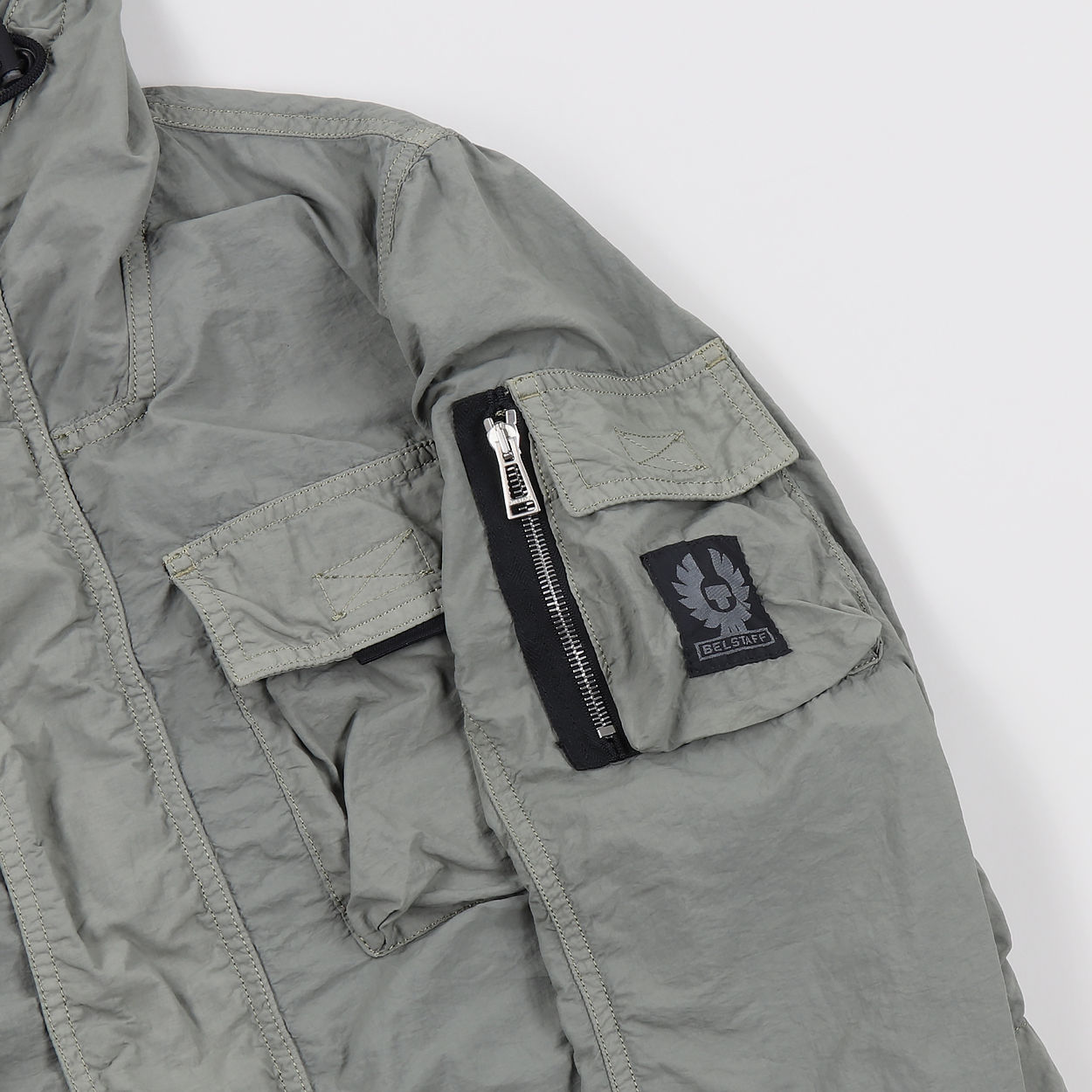 8b08175359 A hooded jacket from the UK's premium Belstaff. A three-in-one, the shell  is made from 100% nylon with five pockets and a two-way zipper, and the  detachable ...