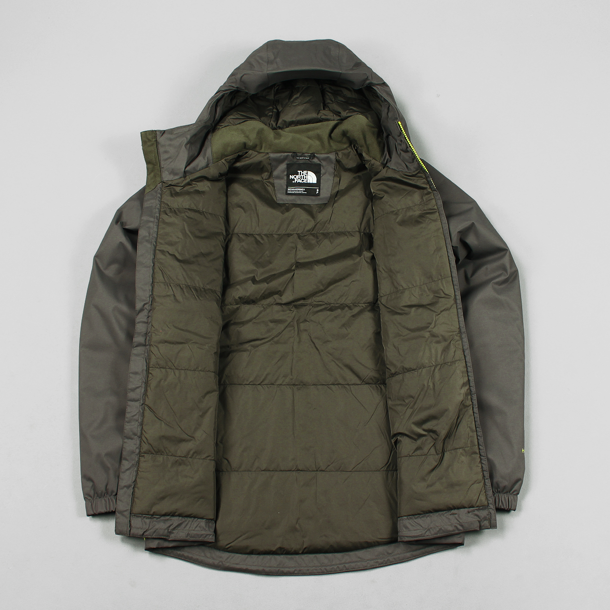 9c170892ceb3 A redesigned version of the iconic Quest jacket from The North Face with a  Heatseeker insulated lining and a Hyvent waterproof shell. In Black Ink  Green.