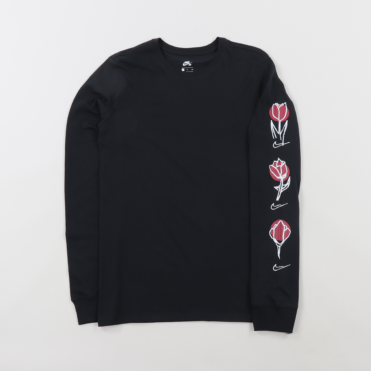 40c14a19380 A long sleeved tee from Nike SB with a Roses graphic printed to the back  and sleeve. Made from 100% cotton with a ribbed crew neck and cuffs.