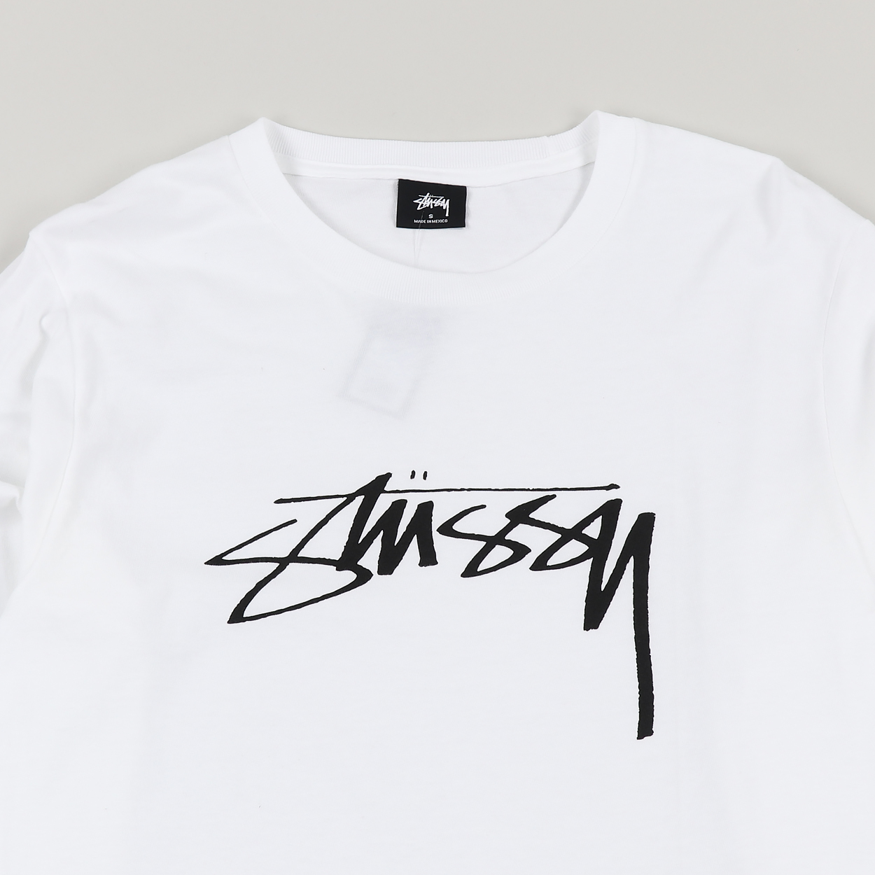 7f9e2ecd19f2 A long sleeve jersey from Stussy with a Smooth Stock graphic print to the  front. Features a ribbed crew neck and cuffs and comes in a regular fit.
