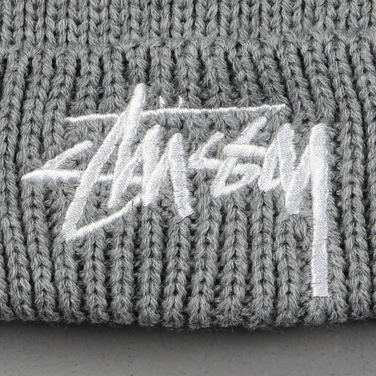 e70bdee717e FA15 Stock from Stussy is arriving quickly with the new Heather Grey Pom  Beanie landing on the scene.