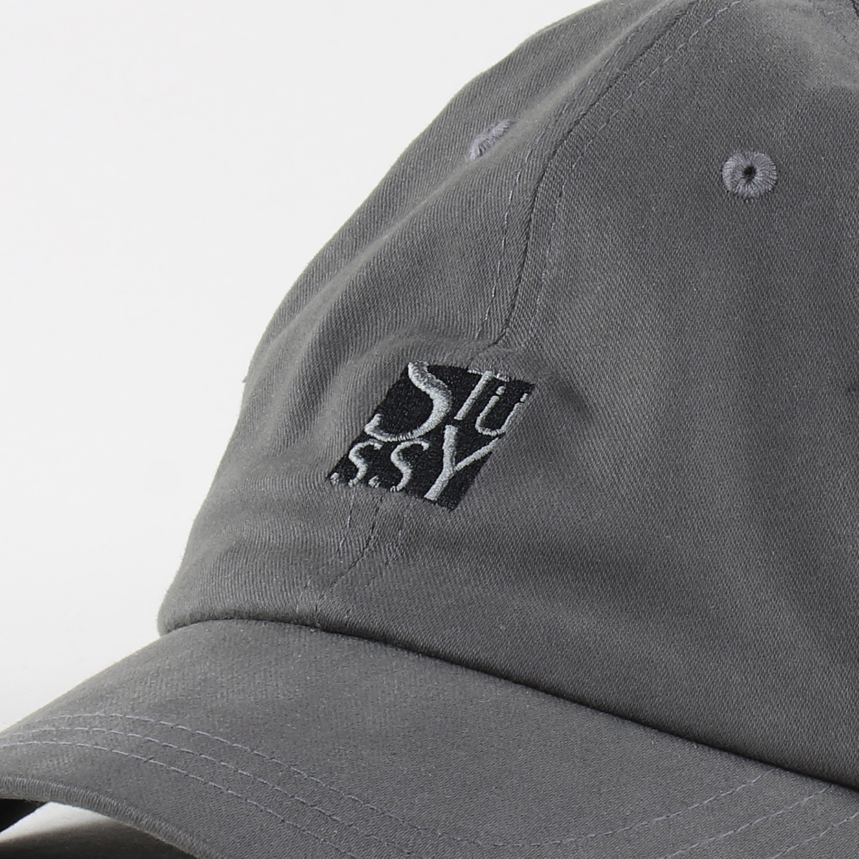 863fe959f6c A cap from Stussy with a logo embroidered to the front. Made from 100%  cotton twill with ventilation holes