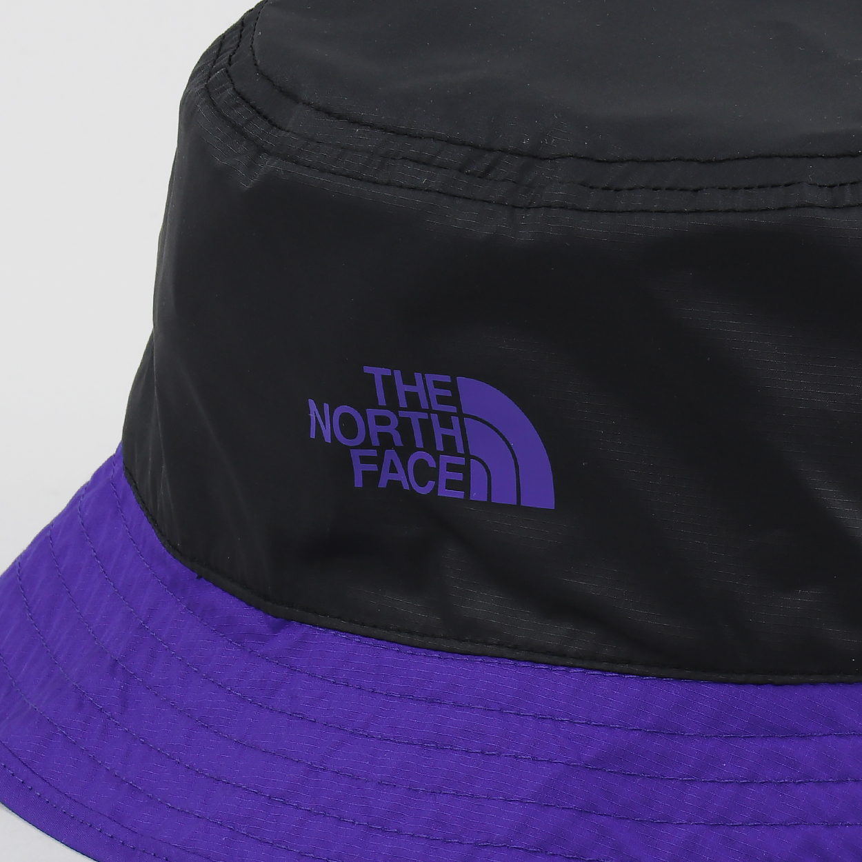 0c0230817e0 A bucket hat from The North Face made from 100% polyester with a reversible  design from the  92 Rage  collection