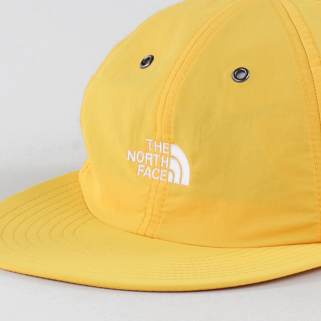 545ba7494cd A cap from The North Face that s made from 100% nylon and features an  embroidered logo to the front. Metallic detailing and a strapback complete  the look.