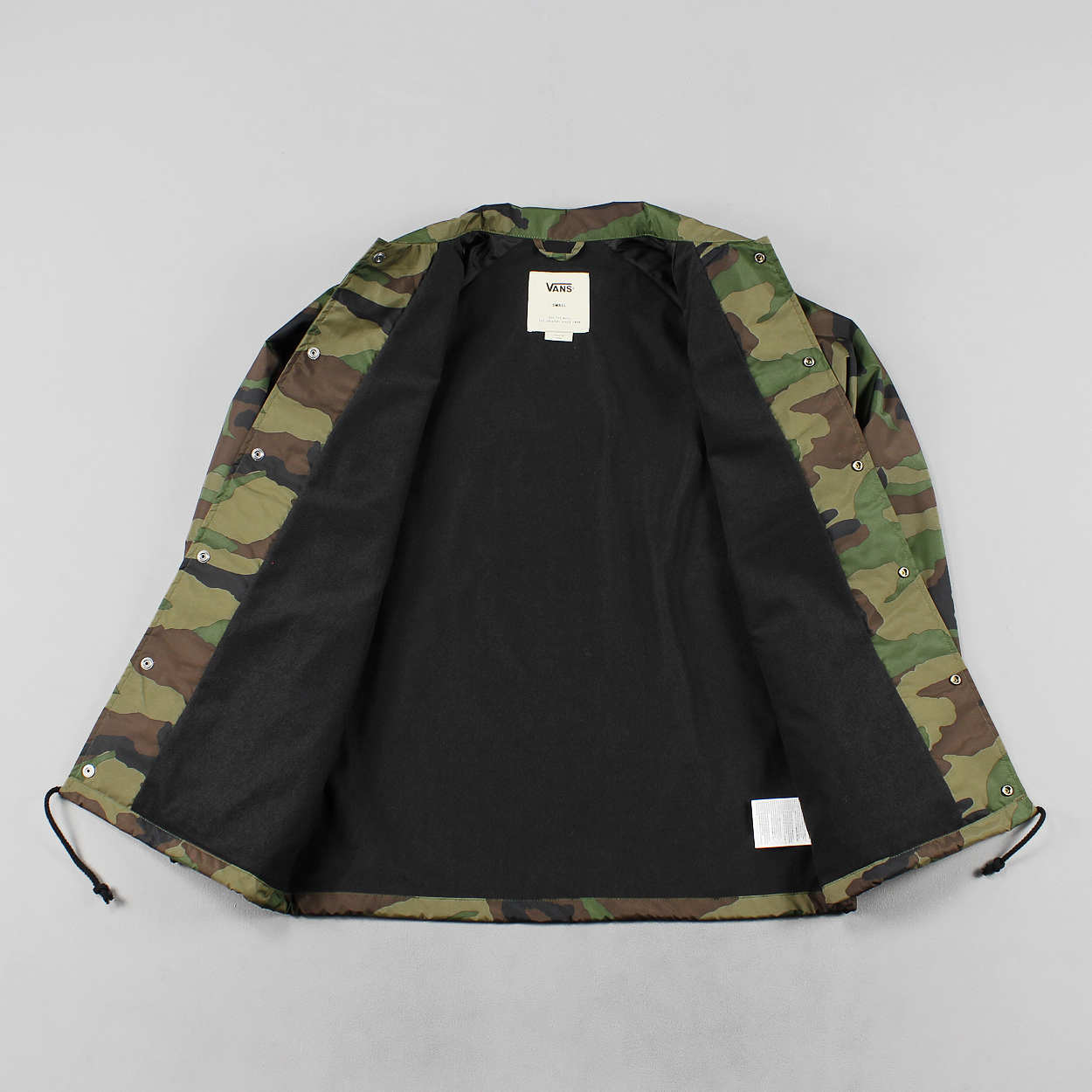 f55d1486831 A spring and summer weight button up windproof coach jacket with a regular  collar